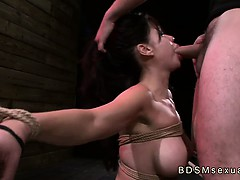Busty tied up Asian babe...